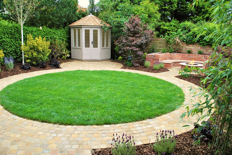 Classic Summer House And Stunning Outdoor Lounge With Fire Table Together  With Subtle Design And Feature Planting Complete This Lovely Town Garden